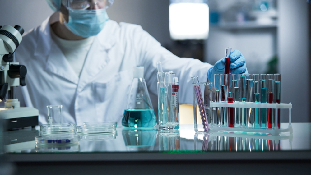 Lab,Worker,Putting,Medical,Blood,Sample,In,Place,After,Examining